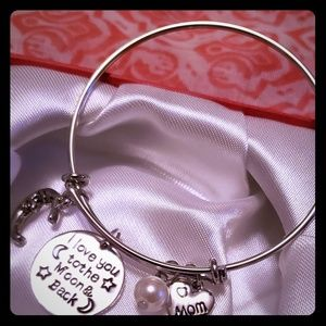 Jewelry - Silver plated bangle with charms.